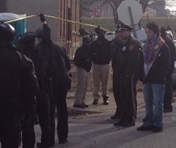 Officers block off the street after a shooting. Big photos below. - SAM LEVIN