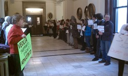 Members of Dump Veolia line the hallway outside the mayor's office.