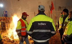 Angry Belgian brewers took hostages and burned pallets in the street - PHOTO BY REUTERS VIA BRISBANE TIMES