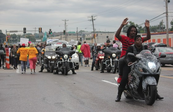 Bikers led hundreds protesters down West Florissant Avenue early Saturday afternoon.