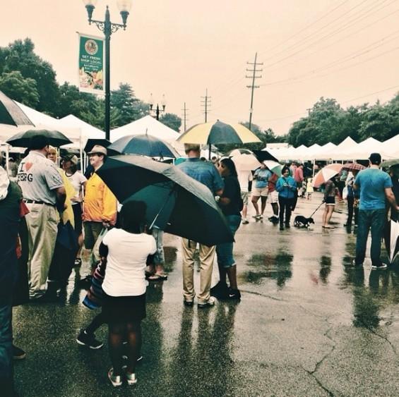 The Ferguson Farmers Market sees showers of love on August 16. - JULIEJAY00 | INSTAGRAM