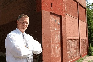 Gary Detmer in front of one of seven dilapitated properties he purchased with the help of Doug Hartmann and Lisa Krempasky. Detmer has sued Krempasky alleging forgery.