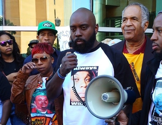 Lesley McSpadden and Michael Brown Sr. outside the Buzz Westfall Justice Center in Clayton. - JESSICA LUSSENHOP