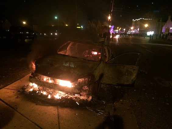What's left of a police car after it was set on fire on South Florissant Road. - MITCH RYALS