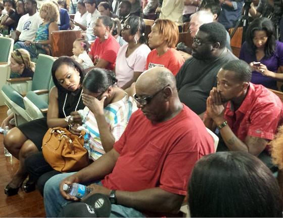 Michael Brown's family wept as Benjamin Crump spoke of the shooting. - JESSICA LUSSENHOP