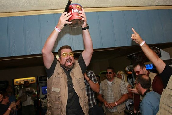 Marcus Bautista looks amazingly like Walter Sobchak from The Big Lebowski -- especially with a can of ashes and a gun. - PHOTOS COURTESY OF MARCUS BAUTISTA