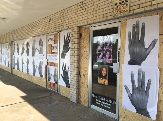 Businesses along West Florissant Avenue in Ferguson prepare for more protests by boarding up. - LINDSAY TOLER