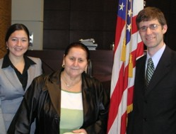 Dan Horkheimer with an unidentified woman (left) and Bosnian immigrant Mine Galijasevic at a naturalization ceremony last December.