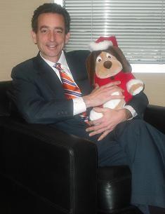 Attorney Al Watkins with a Santa Paws toy.
