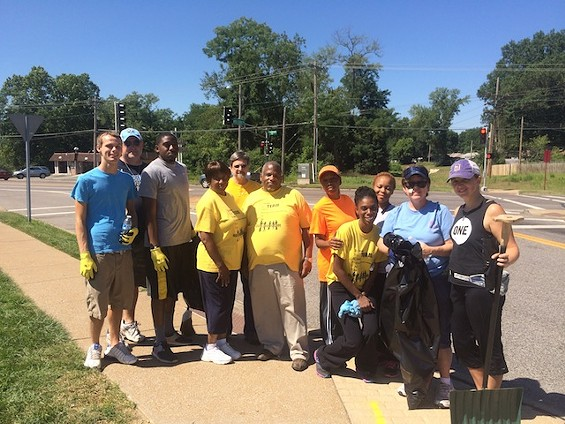 A group of volunteers clean up trash on West Florissant Avenue Wednesday morning. - PHOTOS BY MITCH RYALS