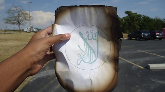 A burned page of a Koran recovered from the blaze that destroyed Joplin's mosque. - FACEBOOK/ISLAMIC SOCIETY OF JOPLIN