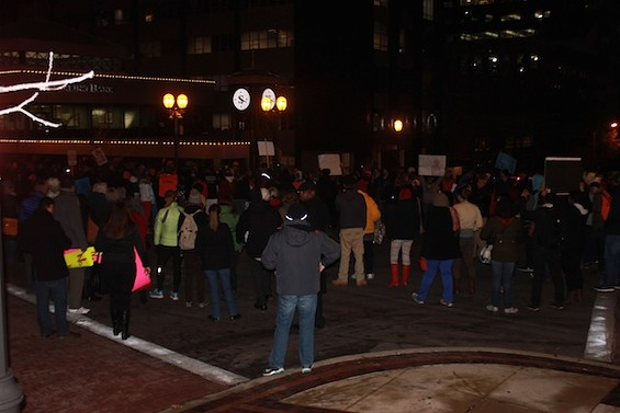 Protesters in Clayton prepare for four and a half minutes of silence in honor of Mike Brown. - MITCH RYALS
