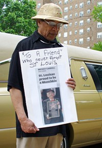 A mourner outside the cathederal today. - PHOTO: CHAD GARRISON