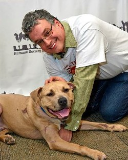 Trooper and Greg, his new owner. - MIKE BIZELLI
