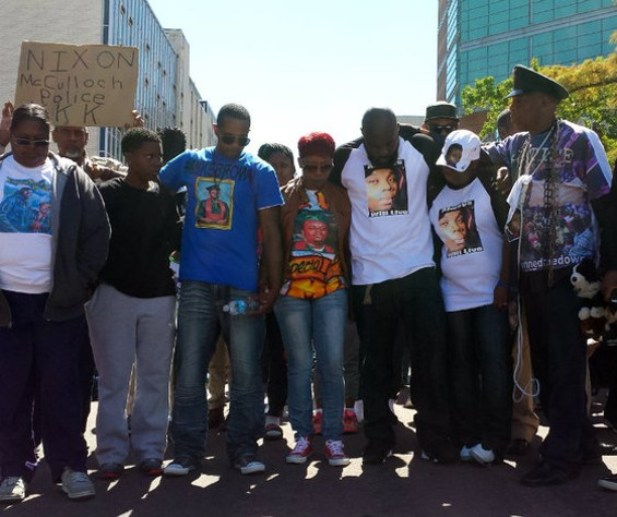 Michael Brown's family at a protest in Clayton last summer. - JESSICA LUSSENHOP