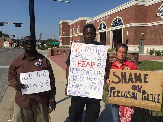 Angelique Kidd (right) in front of the Ferguson Police Department two days before she was arrested and charged with failure to disperse and resisting arrest. - MITCH RYALS