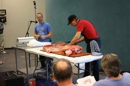 The library hog-butchering in progress. - IMAGE VIA