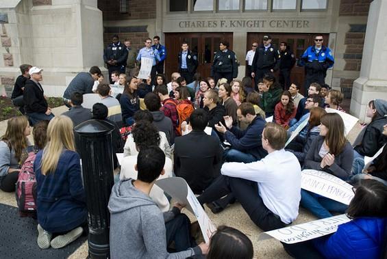 Students and non-student demonstrators protest Peabody Energy outside Washington University.