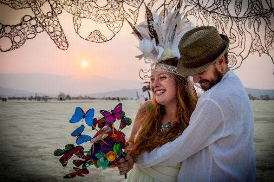 Enjoying their first playa sunset as a married couple. - SARAH CROSS