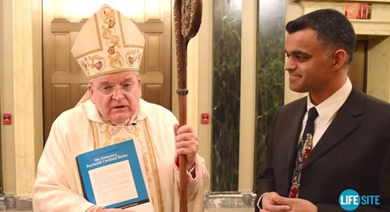 Cardinal Raymond Burke (with the staff) has a problem with women-filled churches and gay clergy. - VIA YOUTUBE