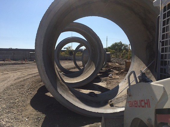 A sewer line under Duncan Avenue had to be torn up to make room for the huge parking lot, which will extend to Forest Park Parkway. These are extra pieces of sewer piping. - MITCH RYALS