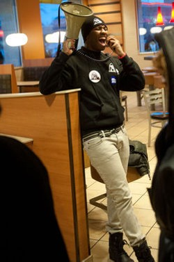 Fast food workers strike inside a McDonalds. - JON GITCHOFF