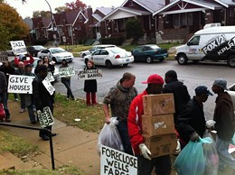 Movers from the sheriff's office ignore protesters, as they empty 4665 Penrose. - LEAH GREENBAUM