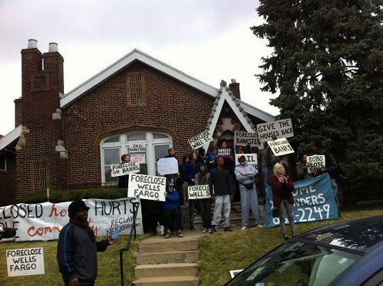 Activists from Occupy, MORE, and Beyond Housing demonstrate outside Williams' home. Some risked arrest by interfering directly with the eviction. - LEAH GREENBAUM