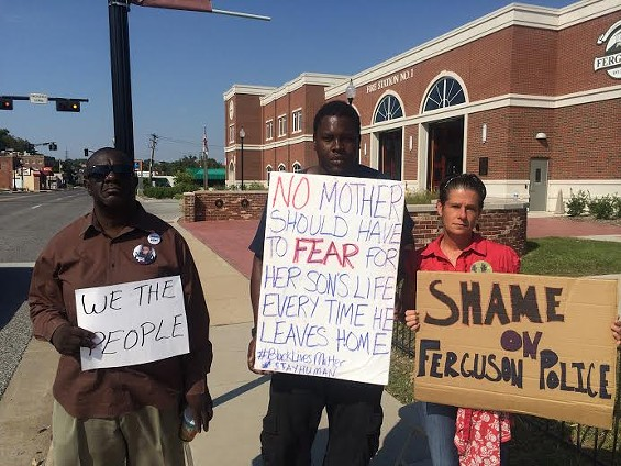 Louis Wilson, left, protests outside the Ferguson Police Department. - MITCH RYALS