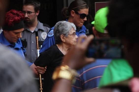 Hedy Epstein, center, is arrested outside the Wainwright Building in downtown St. Louis on August 18. - @DYLANBRADY | TWITTER