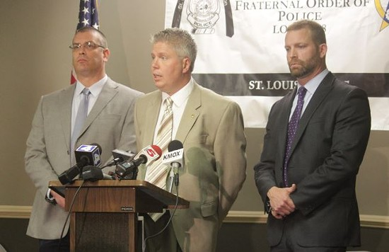 (Left to right) St. Louis Police Officer's Association President Joe Steiger, business manager Jeff Roorda and Brian Millikan, the attorney for the officer who shot and killed Vonderitt Myers on October 8. - DANNY WICENTOWSKI