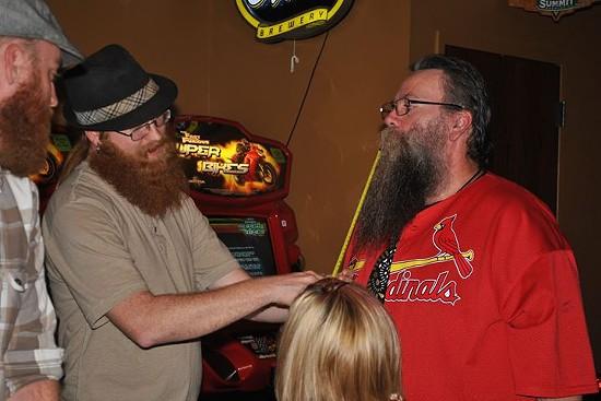 Richie Darling measures a club member's beard. - ST. LOUIS BEARD AND MUSTACHE CLUB