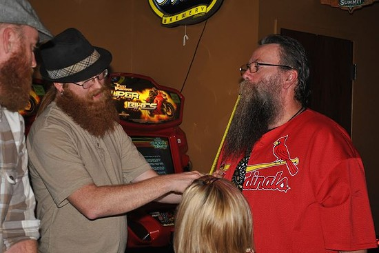 Richie Darling measures a club member's beard. - ST. LOUIS BEARD AND MUSTACHE CLUB