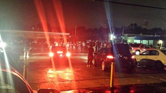 Protesters in Ferguson out past curfew. - DANNY WICENTOWSKI