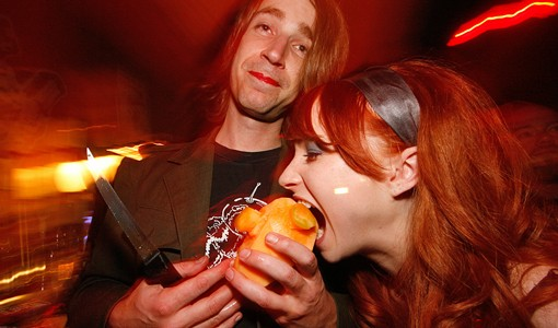 """An attendee of """"Bloody Valentine Eve"""" enjoys a cantaloupe, carved into the shape of a human heart. Ah, Valentine's Day! See more photos from the """"Bloody Valentine Eve"""" party here. - PHOTO: NICK SCHNELLE"""
