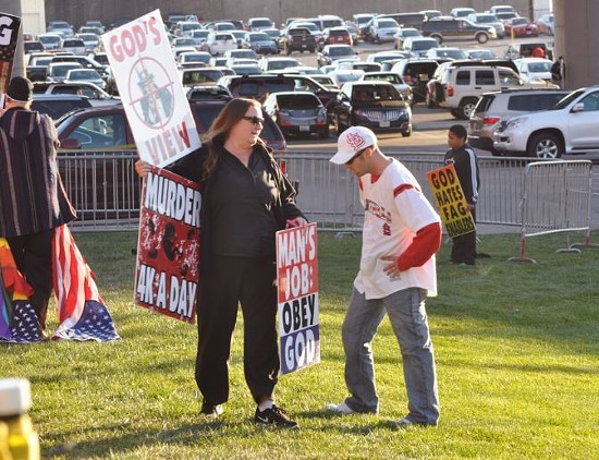 One Cardinals fan ignored the fence and tried to debate a picketer. (Note: The WBC makes it a point to always bring a child to its protests for some fucking reason.) - DANNY WICENTOWSKI
