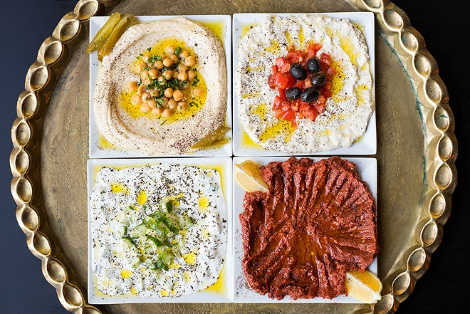 A selection of Levant's cold appetizers and salads: hummus, baba ganoush, yogurt cucumber salad and mouhamara. - MABEL SUEN