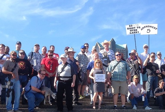 A group of gun-loving compatriots took their firearms for a walk through downtown St. Louis on Saturday. - COURTESY OF JEFFRY SMITH