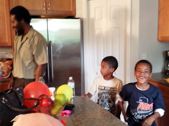 Here is what a kid's face looks like moments after realizing his dad is home from prison (Mike Anderson at left). - JESSICA LUSSENHOP