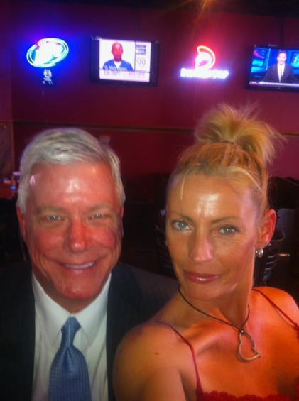 """Peter Kinder with a bartender at Verlin's, a nightspot that proclaims """"every night's a pantless party!"""""""