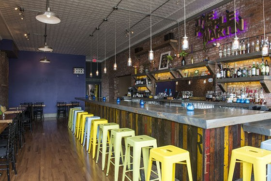 The bar at the Purple Martin in Fox Park, which is made from Refab material. - COREY WOODRUFF