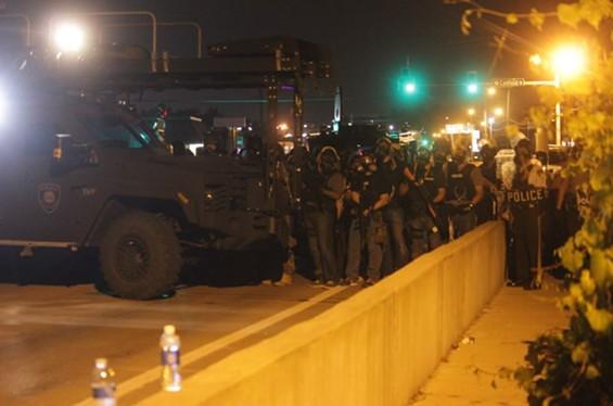SWAT officers gather near the QuikTrip in Ferguson. - DANNY WICENTOWSKI