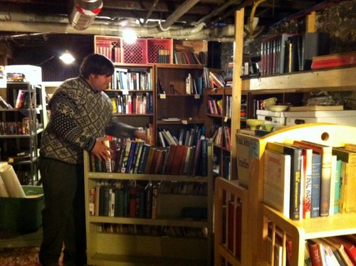 Steven Hoffman unloads box after box of books and prepares them for sale.