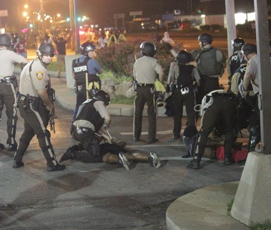 Officers arresting protesters the night of August 18. Nineteen people were charged with failing to disperse that day. - DANNY WICENTOWSKI