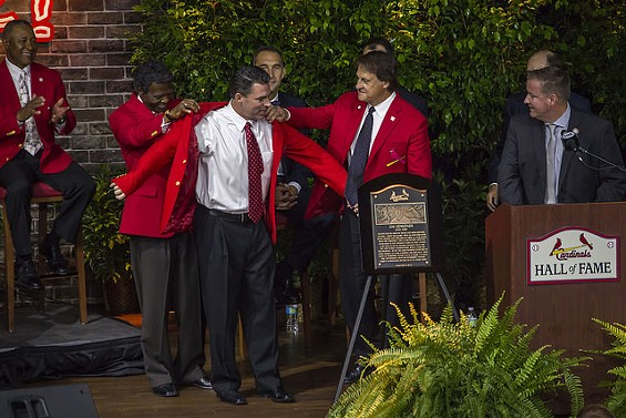 Jim Edmonds gets his red jacket as a new member of the 2014 Class of the St. Louis Cardinals Hall of Fame. - BUZBETO VIA FLICKR