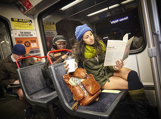 She's got her drink. She's got her magazine. What could she be missing? Oh, that's right -- pants.