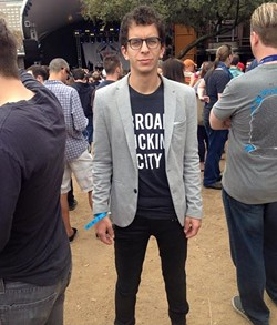 "Podolsky, shown here wearing the ""Broad Fucking City"" shirt at the SXSW festival in Austin, Texas. - COURTESY OF DANIEL PODOLSKY"