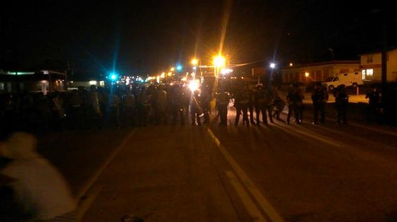 Police face off with about 30 protesters in Ferguson Tuesday night. - RAY DOWNS