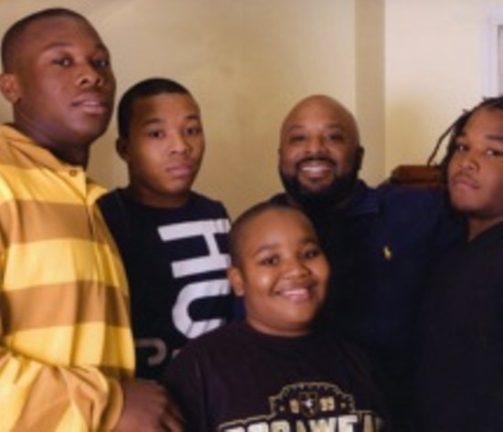 Cary Ball, left, with his father and siblings. - COURTESY OF HIS FAMILY