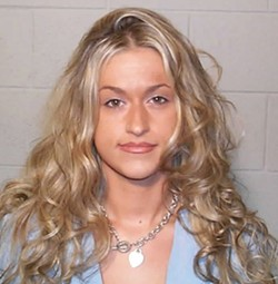 Cohen's former girlfriend, Amanda Eneman, in a 2005 mug shot for prostitution charges. - IMAGE VIA